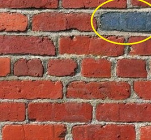 400057-old-red-brick-wall-with-one-odd-blue-brick